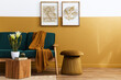 canvas print picture Stylish scandinavian interior of living room with design green velvet sofa, gold pouf, wooden furniture, cacti, carpet, cube, copy space and mock up poster frames. Template.