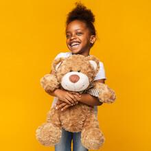Cute Black Girl Embracing Big ...