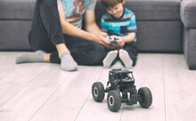 The Father Teaches His Son How To Ride The Radio Control Car