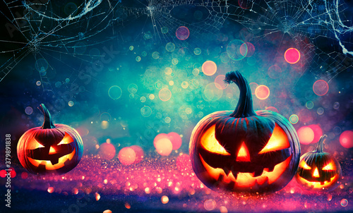 Fototapeta Halloween Abstract Party - Smiling Pumpkins On Defocused Shiny Background  obraz