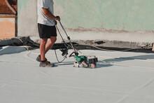 Worker Welding Pvc Roof Membra...