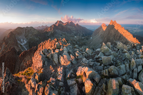 Fototapeta Scenic image of Fairytale mountains during sunset. The sunrise over a mountain in park High Tatras. Slovakia, Europe. Wonderful Autumn landscape. Picturesque view of nature Amazing natural Background obraz