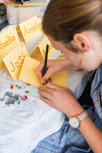 Teen Girl Writing On Hand Made Thank You Cards