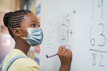 Elementary Girl Wearing Mask A...