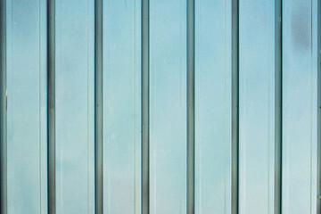 Background of blue metal door in grungy style