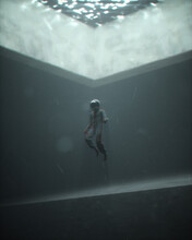 Person In Diving Helmet Suspended Underwater