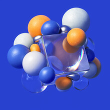Colorful Spheres Clustered Around Glass Cube