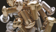 Close Up Of Gold And Silver Hex Screws
