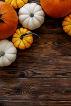 Close Up Shot Of Two Decorative Pumpkins On Grunged Wood Texture Background Bright As A Symbol Of Autumnal Holidays With A Lot Of Copy Space For Text.