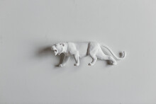 White Panther Figurine On White Surface