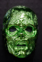 Metallic Green Zombie Mask Isolated Against Black Background