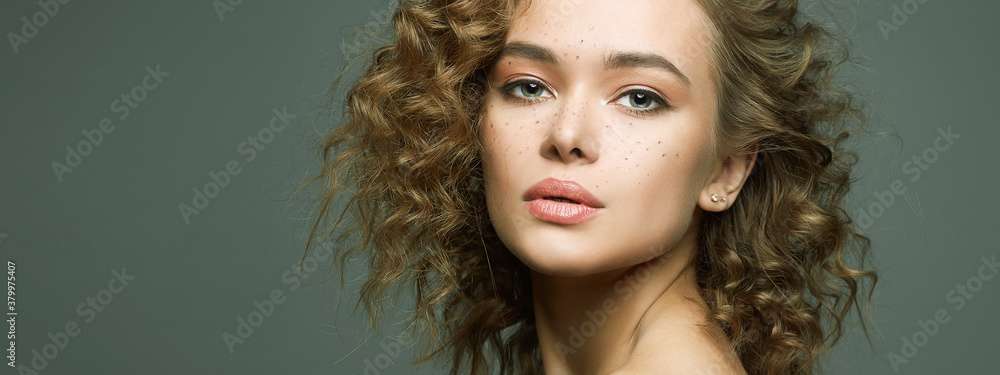 Fototapeta Beautiful freckles woman with curl hairstyle and make-up