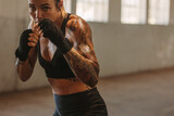 Female doing shadow boxing in training gym