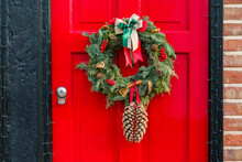Christmas Wreath On Red Front Door To English Home
