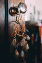 A Dream Catcher In A Bedroom