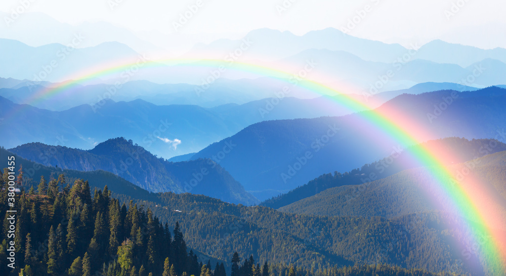 Fototapeta Misty view of the blue mountain range with amazing rainbow -  Beautiful landscape with cascade blue mountains at the morning