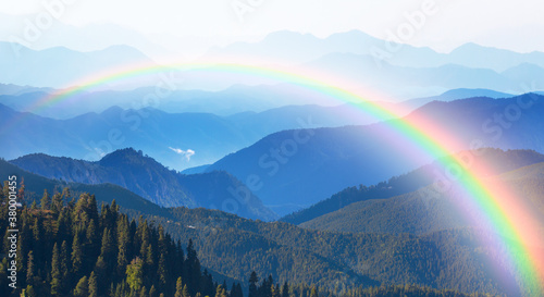Fotografie, Obraz Misty view of the blue mountain range with amazing rainbow -  Beautiful landscap