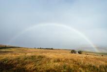 Rainbow Over Moorland And Barn. Cockley Moor, Cumbria, UK.