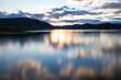 Coucher de soleil en longue exposition sur la Lac du Salagou par temps nuageux (Occitanie, France)