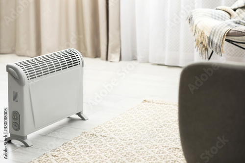 Fototapeta Modern electric heater in stylish room interior obraz