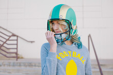 Pretty Girl Posing With Football And Helmet