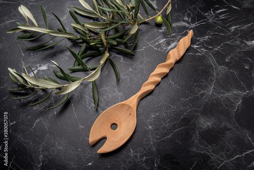 handmade wooden spoon on black marble Fotobehang