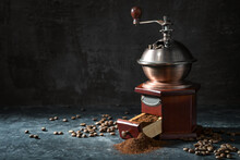 Wooden Vintage Coffee Grinder, Roasted Beans And Ground Coffee On A Dark Rustic Background With Copy Space, Selected Focus