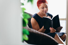 Black Woman Reading A Book At ...