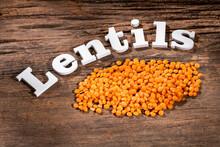 Lens Culinaris - Uncooked Orange Lentils On Rustic Wooden Background