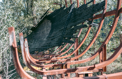Fototapeta Old abandoned wooden bobsleigh track in summer by daylight
