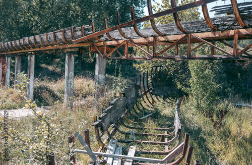 Fotografiet Old abandoned wooden bobsleigh track in summer by daylight
