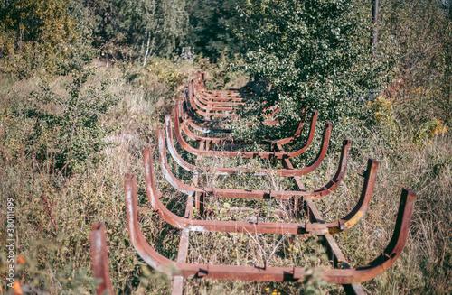 Billede på lærred Old abandoned wooden bobsleigh track in summer by daylight