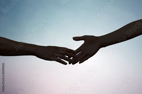 Hands of man and woman reaching to each other Canvas Print