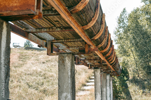 Fotografie, Obraz Old abandoned wooden bobsleigh track in summer by daylight
