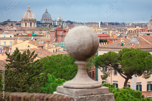 Fototapeta Roman ancient roofs and cupolas . Old Rome cityscape view