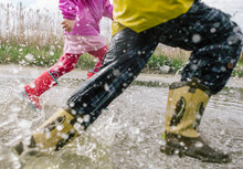 Kids Jumping In Puddle