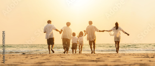 Fototapeta Asian family holidays at the beach.  Happy family in asia Traveling, resting after the virus crisis, living life with family obraz