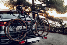 Crossover Car With Two Road Bicycles Loaded On A Rack