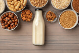 Concept of organic vegan non dairy milk with glass milk bottle and bulk products