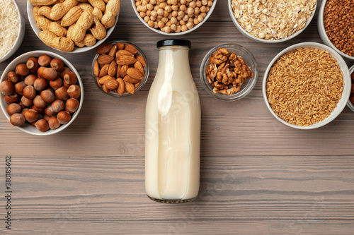 Fototapeta Concept of organic vegan non dairy milk with glass milk bottle and bulk products obraz