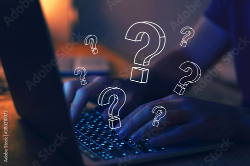 many quiestion marks on computer, find answer online, FAQ concept, what where when how and why, search information on internet