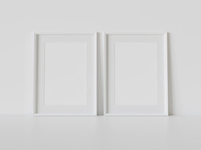 Two White Frames Leaning On White Floor In Interior Mockup. Template Of Pictures Framed On A Wall 3D Rendering