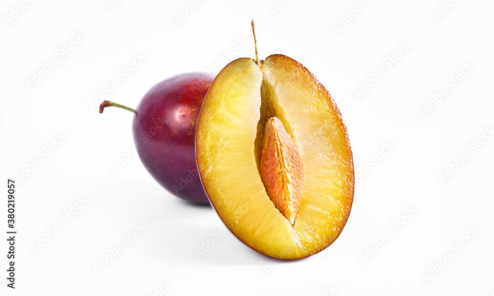 Fototapeta Plum half close up macro shot. Oragnic sweet plums fresh and delicious. Fresh fruit snack. Isolated on white background.