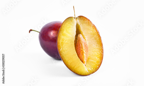 Fototapeta Plum half close up macro shot. Oragnic sweet plums fresh and delicious. Fresh fruit snack. Isolated on white background. obraz
