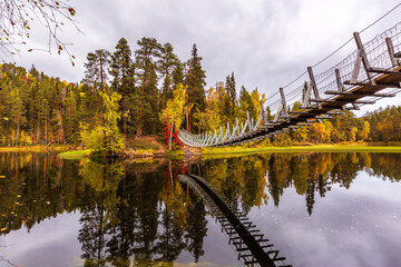 The suspension bridge in the beautiful autumn forest, Oulanka national park, Finland