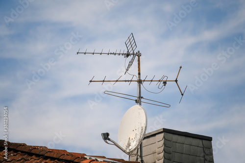 Fotografie, Obraz Satellite dish and terrestrial antenna on the roof against the sky