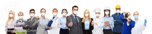 job, occupation and pandemic concept - people of different professions wearing face protective medical masks for protection from virus disease over white background