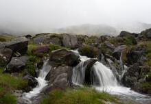 A Raging Waterfall In The Moun...