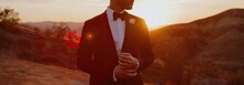 Groom In Tuxedo, White Shirt A...