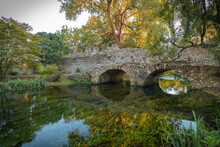 Stone Bridge With Arches And Reflection In The Water In  Province Of Latina In Italy